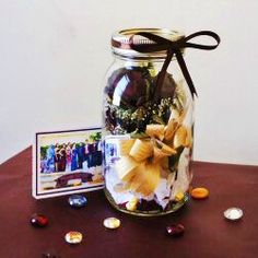 Preserve your high school prom memories in a way such that you won't cringe: dried corsage sealed in a mason jar