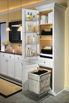 Our Linen Closet is a bathroom essential with its chrome door rack, adjustable shelves, and removable chrome hamper.