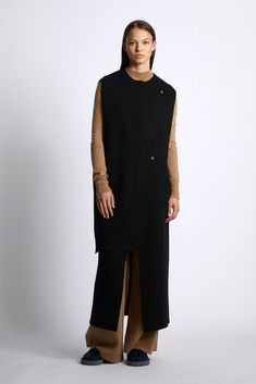 GBP Knitted Cashmere / Wool sleeveless coat with asymmetric double layer front to one side. This style has multiple buttoning options and is great for layering. Sleeveless Coat, Cashmere Wool, Cotton Bag, Wool Coat, Light In The Dark, High Neck Dress, Dresses With Sleeves, Layering, Model