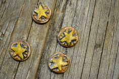 These star charms were fired several times between layerings of stains to give an old, worn look and are finished with a matte glaze. Price is for one 2 cm charm.