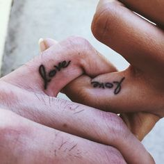 his and hers matching love word finger tattoos