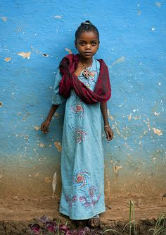 Ethiopian girl in Jinka - Ethiopia. love the colors, and how her dress nearly fades into the background.
