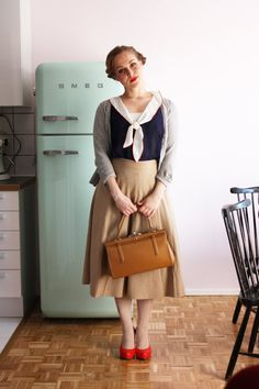 I love the skirt and sweater.  The collar is a bit much but the navy blue and red are nice.