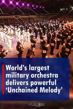 A vast collection of uniformed men and women gather information. But they're not here to make war. They're going to make music. 'Unchained Melody' by The Righteous Brothers, to be precise. The timing and coordination and choreography is astounding. #righteousbrothers #retro #unchainedmelody #orchestra #music