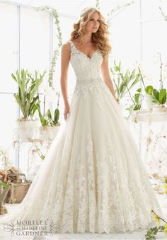 """Wedding Dresses and Wedding Gowns by Morilee featuring Classic Tulle Ball Gown with Crystal Beaded, Alencon Lace Appliques and Wide Scalloped Hemline Removable Beaded Satin Belt included, but also sold separately as Style 11224. Available in Three Lengths: 55"""", 58"""", 61"""". Colors available:White, Ivory, Ivory/Light Gold"""