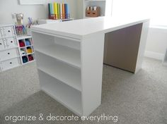 DIY Craft Table; two $15 Walmart bookshelves and sheet of cabinet grade plywood. - I despise these cheap walmart MDF bookshelves, but if I can't afford a desk -- and could paint them and use a total of 4 so that there is a front side with shelves too.