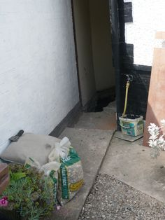 Removal of external timber door with associated removal works.