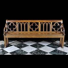 Antique Carved oak hall or church bench, in the Tudor Revival, English Neo Gothic style, with a Puginesque designed back.