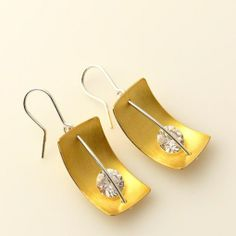 Silver earrings, gold plated with zircon.