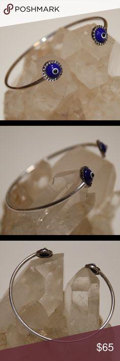 """Sterling Silver Eye Bangle Cuff Bracelet Sterling silver eye (dark blue) cuff bangle bracelet.   * 7"""" inch bracelet  * 5.5 grams * 10mm eye charm  * Stamped 925   Item #BRH003 Jewelry Bracelets"""