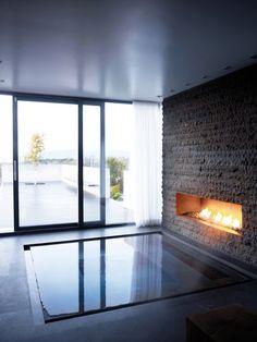 Infinity edge sunken hot tub w/ fireplace;  Sandell Sandberg    How do I incorporate this into the lake house????