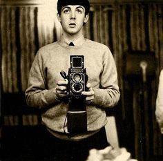 A young Paul McCartney takes a mirror selfie. (1959)