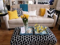 again, that coffee table in the porch area covered into an ottoman. Could even go in the living room or your back tv room?