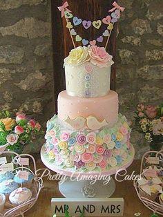 Bunting, birds and rosebuds.  By www.prettyamazingcakes.co.uk