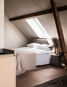 The 50-square-metre guesthouse sleeps just two people and is host to a bedroom, kitchen and lounge, which are nestled beneath the exposed beams of the farmstead's pitched roof.