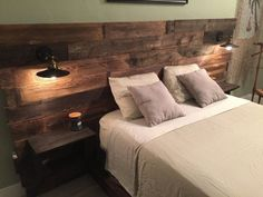 Wood headboard with lights and side tables - possibly entire plank wall?