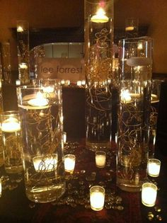 Gold wire submerged for table centerpieces; maybe the smaller/lower glass holders?