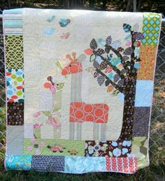 Beautiful baby quilt... I'd like to try doing something like this. Might have to give it a try just for fun and then whoever has the next baby gets it....