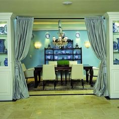 How to separate a formal living and dining room combo with curtains.