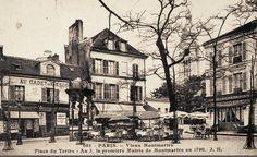 """place du Tertre - Paris 18e - La place du Tertre avec le restaurant """"Au Cadet de Gascogne"""" et la première mairie de Montmartre, vers 1900."""