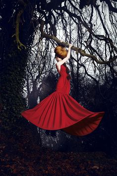 hang on, weekend's almost here! glam red gown in woods