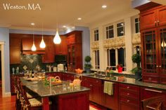 Kitchen Island, seating, build in prep sink, craftman style legs, cherry wood cabinets, granite countertops,