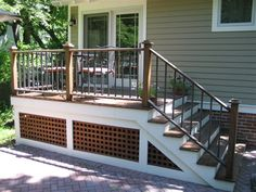 Like the combo of white paint and dark wood on this deck skirting.