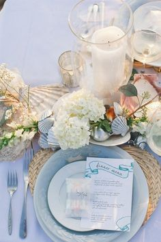 The perfect place setting for a beach side wedding @gildedlilyevent
