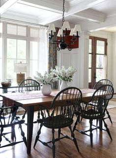 Paint the chairs black to break up the wood table and floor.