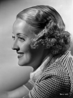 Bette Davis Portrait Side View smiling in Knitted Short Sleeve Shirt and Short Curls Premium Art Print