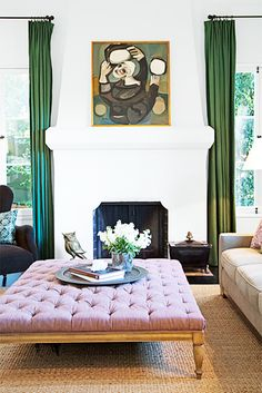 Your Guide to Decoding Popular Décor Lingo// tufted ottoman, coffee table ottoman, green drapery, white fireplace, modern fireplace