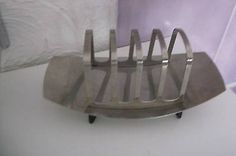 Buy VINTAGE OLD EAMES STYLE STAINLESS STEEL TOAST RACKfor R50.00