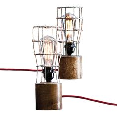 This stripped down, industrial-chic lamp features a metal cage structure protecting the light bulb inside (sold separately). It's edgy and f...