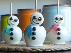 White Chocolate Snowmen Apples | Roll up those sleeves and let's get crafty!These fantastic treats are not only delicious, but they're a lot of fun to assemble. For some truly fun holiday treats, these crafty desserts make a great kid-friendly activity. From fun Christmas tree treats, to iced cookies, to edible snowmen, these fun sweet treats make the perfect addition to a holiday party or even on Santa's cookie plate. Spread the holiday cheer by sharing these fun desserts with friends and