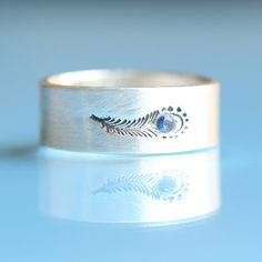 PEACOCK FEATHER ring, SAPPHIRE and eco-friendly silver, artwork by boygirlparty.  Handcrafted by Chocolate and Steel (small) via Etsy