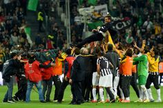 Antonio Conte head coach of Juventus FC is lifted by his players after beating Atalanta BC 1-0 to win the Serie A Championships at the end o...