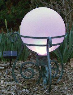Illuminated gazing ball on wrought iron legs - I want one of these!