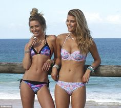 Beach babes: Sports Illustrated cover girl Nina Agdal stripped down to her bikini for famous surf wear brand Mambo alongside Australian model and fashion blogger Caitlyn Paterson in Sydney this week