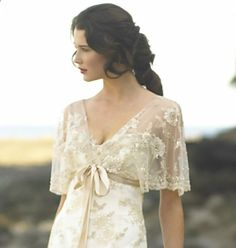 I have no excuse to ever wear a wedding dress again, but this is just beautiful. :)  dress with butterfly sleeves by Stephanie Allin