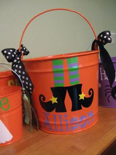 personalized treat bucket... Definitely plastic (reinforced handles) and could totally DIY