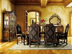 Inspired by designs of central Italy, our Grand Tuscan dining collection has distinguished silhouettes, lavish carvings, and rich finishes. Luxurious top-grain leather accents, Jacobean twist details and turned cast-iron finials add a touch of romantic appeal. New Zealand pine solids and veneers. Multi-step warm java finish.      HVT40000 DIN  Additional Details
