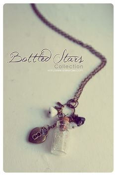 Tiny Bottle necklace with glass flowers
