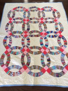 "Vintage Handmade Quilt, ""Double Wedding Ring"" Pattern, Multicolored with Blue Edging, White Backing, Blanket/Throw by eddysmercantile on Etsy"