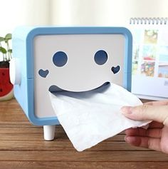 Smiley Face Tissue Box. how cute and it's $9.99.  http://www.yesstyle.com/en/lazy-corner-smile-face-tissue-box-light-gray-one-size/info.html/pid.1032309068