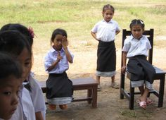 Laotian school children waiting patiently to have their vision tested