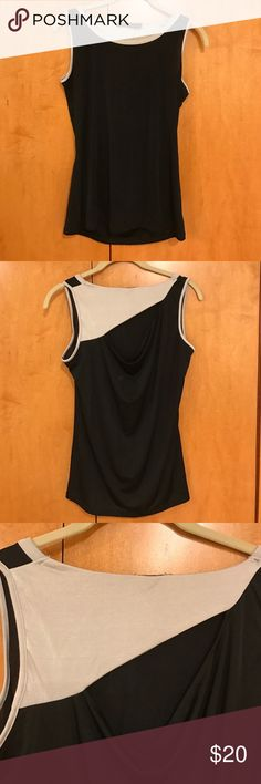 Black and Grey Cutout Tank Polyester Spandex top from the limited. Size M, never worn. Cute open back! The Limited Tops Tank Tops