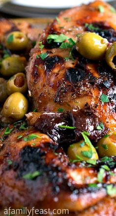 Chicken Marbella Recipe ~ it's moist and tender with a crispy skin, and the marinade cooks into a wonderful sweet and sour sauce with Mediterranean-inspired flavors that is really delicious!