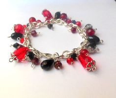 Silver colour bracelet with red, black glass beads.
