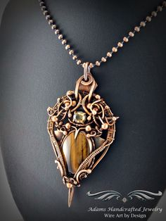 """Ambrosia -- Once Upon a Time"" Chatoyant Tiger's Eye pendant necklace in an antiqued copper finish adorned w/ a faceted Citrine gemstone (1.25 ct). Original design by Daryl Adams. **Currently Available**"