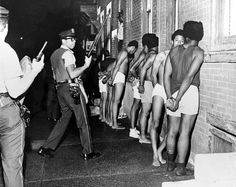 Members of the Black Panther Party, stripped, handcuffed, and arrested after Philadelphia police raided their headquarters, August, 1970. The party decided on Philadelphia as the site of its convention. On the Saturday before the convention a murder was committed; a Philadelphia policeman was shot and killed. On August 31, 1970, heavily armed police raided three Panther Offices; 2935 Columbia Avenue, 3625 Wallace Street, and 428 W. Queen Lane.